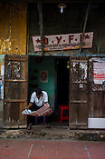 A party worker reads the newspaper at Communist party offices in Kochi, Kerala, India.