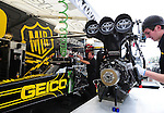 Jan. 17, 2012; Jupiter, FL, USA: A crew member for NHRA top fuel dragster driver Morgan Lucas works on the engine in the pits during testing at the PRO Winter Warmup at Palm Beach International Raceway. Mandatory Credit: Mark J. Rebilas-
