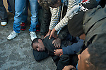 An African immigrant protestor is comforted by his friends as protestors are arrested in front of the Israeli parliament, the Knesset, in Jerusalem, Israel. Some 200 African asylum-seekers, who illegally entered Israel, demonstrated against their condition at a detention facility, from which they walked out of two days earlier. Israeli police and immigration arrested all protestors, and sent them back to Saharonim detention facility in the Negev desert.