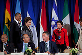 United States President Barack Obama, left, and President Dilma Rousseff of Brazil, second left, arrive for a meeting of the Open Government Partnership, a global effort to make governments better at the Waldorf-Astoria in New York, New York on Tuesday, September 20, 2011.  Seated at the table sharing some thoughts are President Felipe Calder&oacute;n of Mexico and Jens Stoltenberg, Prime Minister of Norway..Credit: Allan Tannenbaum / Pool via CNP
