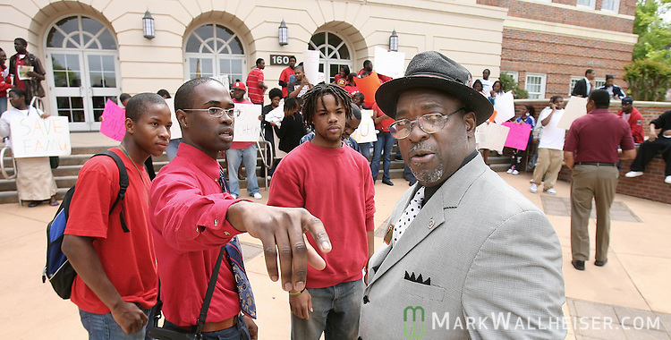 """FAMU protest leader Amir Shabazz, second from left, discusses with Delmas Barber, right, the Director of Community Development, about the location of the protest that was being held on the steps of the administration building.  """"Do it right"""" said Barber of the protest.  """"Take the high road"""" he added in reference to moving the protest across the street so business could be conducted at the administration building. The protest was on the FAMU campus  in Tallahassee, Florida April 11, 2007  (Mark Wallheiser/TallahasseeStock.com)"""