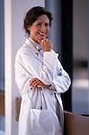 portrait of smiling woman doctor in hospital corridor