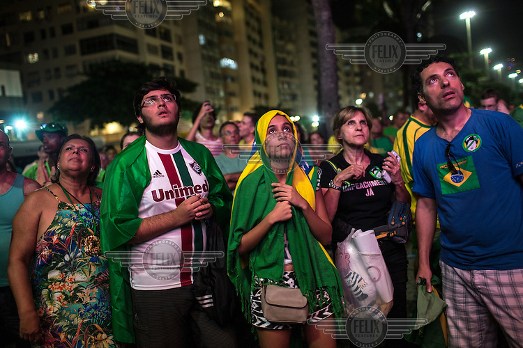 Anti-government protestors, gathered on Copacabana Beach to watch events on a live television broadcast, cheer as it becomes clear that deputies of the Lower House of Congress have voted to start the impeachment of President Dilma Rousseff. Now the Senate will vote, in early May, and if they agree with the Lower House then President Rousseff will be suspended for six months pending an impeachment trial, and her rival, vice-president Michel Temer, will take office.