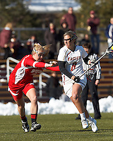 Boston College attacker Covie Stanwick (8) on the attack as Boston University attacker Nell Burdis (16) defends..Boston College (white) defeated Boston University (red), 12-9, on the Newton Campus Lacrosse Field at Boston College, on March 20, 2013.