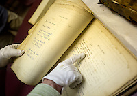NWA Democrat-Gazette/JASON IVESTER --03/31/2015--<br /> Carolyn Reno, collections manager, displays pages in a mid-1800's Bible on Tuesday, March 31, 2015, inside the Shiloh Museum of Ozark History in Springdale.