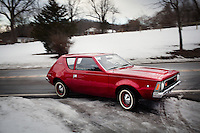 Reinholds, Pennsylvania, February 10, 2015 - Brian Moyer driving his fully restored 1971 AMC Gremlin Base Model outside his home in Reinholds, PA. <br /> <br /> Moyer owns 16 AMC Gremlins. The Gremlin was introduced on April Fools Day (April 1) in 1970 featuring a shortened Hornet body with a Kammback tail and was manufactured in the US via AMC and in Mexico via AMC's subsidiary VAM. It's lifecycle ended in 1978 when it was replaced by the AMC Spirit. Moyer became interested as a kid when he saw the early Gremlin commercials in 1970. His first car was a Gremlin and he has never not owned one. Today he has arguably the most unique collection of Gremlins in the world, including several that are one-of-a kind models. <br /> <br /> CREDIT: Daryl Peveto for The Wall Street Journal<br /> Photo Assignment ID: 36892 <br /> Slug: MYRIDE_Gremlin