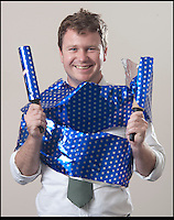 BNPS.co.uk (01202 558833)<br /> Pic: PeterWillows/BNPS<br /> <br /> So simple, even men can do it...<br /> <br /> The answer to every males gift wrapping nightmares - Man Wrap.<br /> <br /> An easy-to-use type of wrapping paper has been invented just for men in a bid to get them to start presenting neatly covered gifts.<br /> <br /> The blue, star patterned gift-wrap can be used without scissors or sellotape and can cover an item in seconds.<br /> <br /> Users simply have to roll out the paper and place their gift in the centre, tear off a strip and then twist it around the present to secure it in place.<br /> <br /> It was created by designer Martin Grix who was shocked at the sheer amount of men he heard found the wrapping process difficult and were even resorting to using bin liners.<br /> <br /> He came up with the unique roll of paper, 'Man Wrap', as a solution in the hope that it would encourage men to start covering their gifts.<br /> <br /> The tube of decorative paper provides 16ft of gift-wrap with a width of 8ins to coat small presents such as boxes and bottles.<br /> <br /> It costs 4.99 pounds from www.themonsterfactory.com