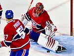 10 April 2010: Montreal Canadiens' goaltender Jaroslav Halak makes a first period save during the last game of Montreal's regular season against the Toronto Maple Leafs at the Bell Centre in Montreal, Quebec, Canada. The Leafs defeated the Habs 4-3 in sudden death overtime, as the Canadiens advance to the Stanley Cup Playoffs with the single point. Mandatory Credit: Ed Wolfstein Photo