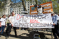 London, 08/05/2016. Today, &quot;Campaign Against Climate Change&quot; held a demonstration to protest against the policies of the British Conservative Government in tackling climate change and to accuse it of not supporting enough clean energy technology. Then protesters, activist and members of the public marched backward from Trafalgar Square to the Department of Energy and Climate Change, Downing Street, Department of Health (Opposite the Treasury). From the organisers Facebook page: &lt;&lt;No more UK backtracking on climate! Since May 2015 clean energy technology has been sidelined in favour of a dash for gas, insulation cut and fracking, roads and runways pushed through despite strong local opposition. So what better way to mark the government's one year anniversary than to march - backwards - down Whitehall? A creative and colourful protest that will make a serious point: we're running out of time to act on climate change, and we can't afford to go backwards. [&hellip;]&gt;&gt;. The demonstration was supported by: Art Not Oil, Biofuelwatch, Campaign for Better Transport, Client Earth, Climate Revolution, Fuel Poverty Action Group, Global Justice Now, Greenpeace, HACAN, Plane Stupid, Reclaim the Power, Solar Trade Association, Talk Fracking, Time to Cycle, War on Want, The Truth about Zane.<br /> <br /> For more information please click here: https://www.facebook.com/events/1694984727439786/?active_tab=highlights &amp; http://www.campaigncc.org/goingbackwards