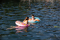 """Swimmers beat the scorching Texas heat by swimming in the constant 68-degree waters of Barton Springs Pool, a spring-fed swimming hole in Austin, Texas' Zilker Park. Voted the """"Best Swimming Hole in Texas."""""""