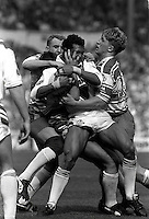 Pix:Michael Steele/SWpix...St Helens v Wigan. Rugby League. From the book 'When Push Comes to Shove'....COPYRIGHT PICTURE>>SIMON WILKINSON..When push comes to shove....St Helens Alan Hunte is tackled by the Wigan defence.