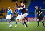 St Johnstone v Hearts..15.12.12      SPL.Ryan Stevenson climbs over Steven MacLean.Picture by Graeme Hart..Copyright Perthshire Picture Agency.Tel: 01738 623350  Mobile: 07990 594431
