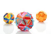 New York, NY, USA - November 4, 2011: Three Ishibashi balls designed by Japanese Origami artist Minako Ishibashi. Each piece is folded from multiple pieces of colored paper by Esme Cribb.