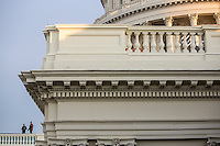 Police officers keep watch from the roof of the U.S. Capitol ahead of President Barack Obama's inauguration on Monday, January 21, 2013 in Washington, DC.