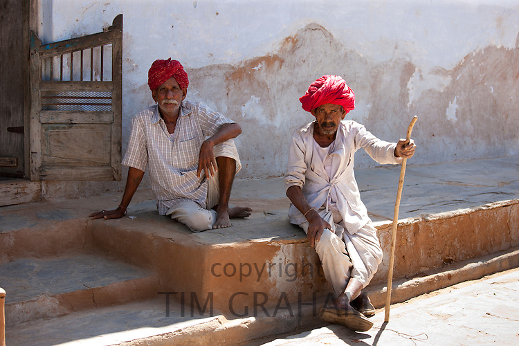 Indian men wearing traditional clothing and Rajasthani turbans in village of Nimaj, Rajasthan, Northern India