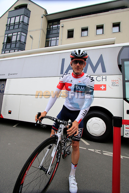 Mathias Frank (SUI) IAM Cycling outside the team bus before the start of Stage 3 of the 2016 Tour de France, running 223.5km from Granville to Angers, France . 4th July 2016.<br /> Picture: Eoin Clarke | Newsfile<br /> <br /> <br /> All photos usage must carry mandatory copyright credit (&copy; Newsfile | Eoin Clarke)