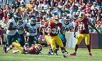 Washington Redskins running back Matt Jones (31) carries for a good gain late in the second quarter against the Philadelphia Eagles at FedEx Field in Landover, Maryland on Sunday, October 16, 2016.  In pursuit are Philadelphia Eagles defensive tackle Fletcher Cox (91), defensive end Connor Barwin (98), outside linebacker Nigel Bradham (53), and nose tackle Beau Allen (94).  Other visible Redskins include center Spencer Long (61) and Washington Redskins tackle Trent Williams (71). The Redskins won the game 27 - 20.<br /> Credit: Ron Sachs / CNP /MediaPunch