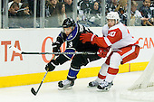 Jack Johnson (Los Angeles Kings, #3) vs Drew Miller (Detroit Red Wings, #20) during ice-hockey match between Los Angeles Kings and Detroit Red Wings in NHL league, February 28, 2011 at Staples Center, Los Angeles, USA. (Photo By Matic Klansek Velej / Sportida.com)