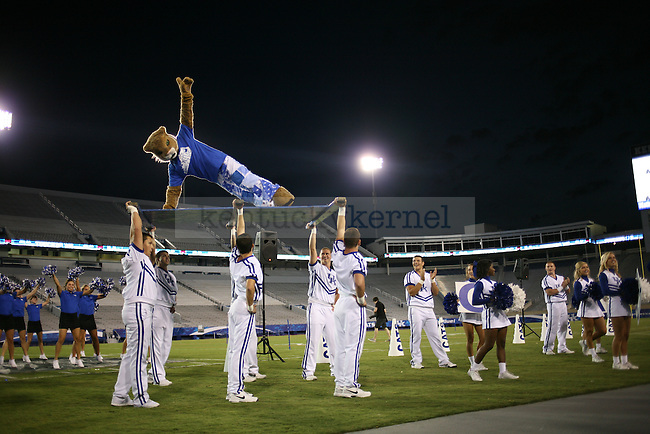 The Wildcat does push ups at Big Blue U at Commonwealth Stadium on Saturday, August 18, 2012. Students were invited to come learn the cheers and fight song and then pose for a picture on the field. Photo by Tessa Lighty | Staff