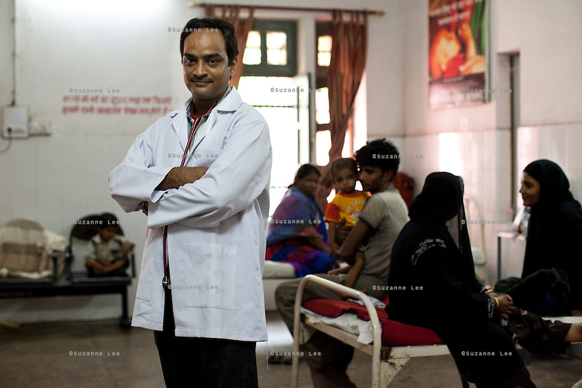"Dr. Vikasendu Agarwal, the paediatrician of the Muradnagar Community Health Centre (CHC), poses for a portrait in the paediatrics ward of the CHC in Ghaziabad, Uttar Pradesh, India. He says that ""Bigger incentives should be given to women to have a tubectomy done after 2 children instead of the current plan of giving incentives for every child born institutionally as the in most cases,money goes directly to the household instead of the mother's healthcare defeating the very purpose of this incentive. The growth-rate between different socio-cultural population groups in the region are drastically different due to lack of awareness of the benefits of family planning in certain groups"". Photo by Suzanne Lee / Panos London"