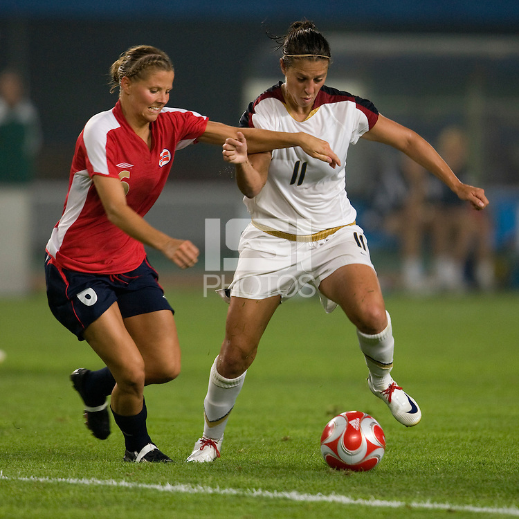 USWNT midfielder (11) Carli Lloyd fights for the ball with Norwegian midfielder (6) Marie Knutsen during first round play for the 2008 Beijing Olympics in Qinhuangdao, China. .  The US lost to Norway, 2-0, at Qinhuangdao Stadium.