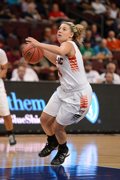 March 7, 2014; Las Vegas, NV, USA; Pacific Tigers guard Madison Parrish (11) dribbles the ball against the Portland Pilots during the first half of the WCC Basketball Championships at Orleans Arena.
