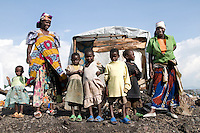 Nyirahabimana (woman left) stands with her sister Maombi (woman right) and their children at the Kabati IDP (Internally Displaced Persons) camp.