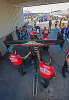 Sep 23, 2016; Madison, IL, USA; Crew members stand with the dragster of NHRA driver Leah Pritchett, pilot of the Papa Johns Pizza sponsored top fuel dragster of Don Schumacher Racing during qualifying for the Midwest Nationals at Gateway Motorsports Park. Mandatory Credit: Mark J. Rebilas-USA TODAY Sports