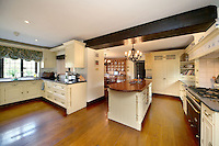 BNPS.co.uk (01202 558833).Pic: Savills/BNPS..***Please use full byline***..Bond probably didn't spend to much time in the kitchen...This quintessentially English property a short Aston Martin drive from the centre of London is leaving potential buyers shaken and stirred...Its the former home of James Bond star Roger Moore, where he lived when he shot his first three 007 movies in the 1970's.. .Sherwood House lies 20 miles west of central London in the village of Denham, Bucks.. .Moore's former home includes five bedrooms, a drawing room, study, library, gym, conservatory and of course a snooker room, wine cellar and swimming pool.. .The 11-acre property also has an annexe and guesthouse.. .Moore was the longest serving James Bond actor, spending 12 years in the role and featuring in seven Bond films from 1973 to 1985...Any potential buyers wanting to live the life of one of Her Majestys Secret Agents will have to find £4.5 million for the property.