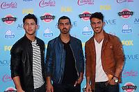 LOS ANGELES - AUG 11:  Nick Jonas, Joe Jonas, Kevin Jonas at the 2013 Teen Choice Awards at the Gibson Ampitheater Universal on August 11, 2013 in Los Angeles, CA