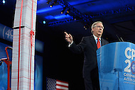 March 14, 2013  (National Harbor, Maryland)  Senate Minority Leader Mitch McConnell points to a prop he used as he addresses attendees of the 2013 Conservative Political Action Conference (CPAC) in National Harbor, MD on March 15, 2013.  (Photo by Don Baxter/Media Images International)