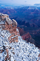 Dawn light on snow covered Grand Canyon from Mather Point, Arizona, USA