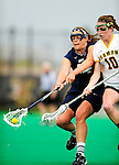 1 May 2010: University of New Hampshire Wildcat midfielder Allie Duclos, a Junior from South Windsor, CT, battles University of Vermont Catamount midfielder Megan MacDonald, a Junior from Wayland, MA,  at Moulton Winder Field in Burlington, Vermont. The visiting Wildcats defeated the Lady Catamounts 18-10 in the last game of the 2010 regular season. Mandatory Photo Credit: Ed Wolfstein Photo