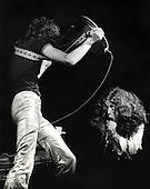 Jimmy Page waves his guitar at Robert Plant, members of Led Zeppelin in a concert at the Met Sports Center in Minneapolis in 1970.