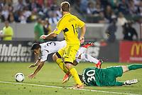 CARSON, CA - July 4, 2013: LA Galaxy forward Jose Villarreal (33) is fouled by Columbus Crew goalkeeper Andy Gruenebaum (30) during the LA Galaxy vs Columbus Crew match at the StubHub Center in Carson, California. Final score, LA Galaxy 2, Columbus Crew 1.