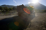 A dump truck moves near the makeshift town in Tzanchaj , Guatemala on Wednesday, March 21, 2007. A deadly mudslide here was spawned by rains associated with Hurricane Stan in October 2005. Initially, up to 500 Tzujutil Maya villagers were believed to have been killed in Panabaj by the mudslide, which essentially  wiped away the town. Construction in the shelter town was halted after the area was deemed to be of high risk. Forensic anthropologists from the Fundación de Antropología Forense de Guatemala have been working to unearth the bodies of the missing and have recovered more than 100. They have also found the number of missing to be lower than originally thought, after many people were located in shelters or living in other towns after the disaster.