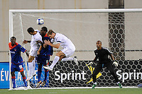 Charlie Davies (9) and Jimmy Conrad (12) of the United States (USA) battle Judelin Aveska (8) of Haiti (HAI) for a header. The United States and Haiti played to a 2-2 tie during a CONCACAF Gold Cup Group B group stage match at Gillette Stadium in Foxborough, MA, on July 11, 2009. .