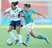 17 August 2004:    Julie Foudy battles for the ball against Heather Garriock from Australia during the second half of the game at Kaftanzoglio Stadium in Thessaloniki, Greece.     USA defeated Australia, 0-0.   Credit: Michael Pimentel / ISI