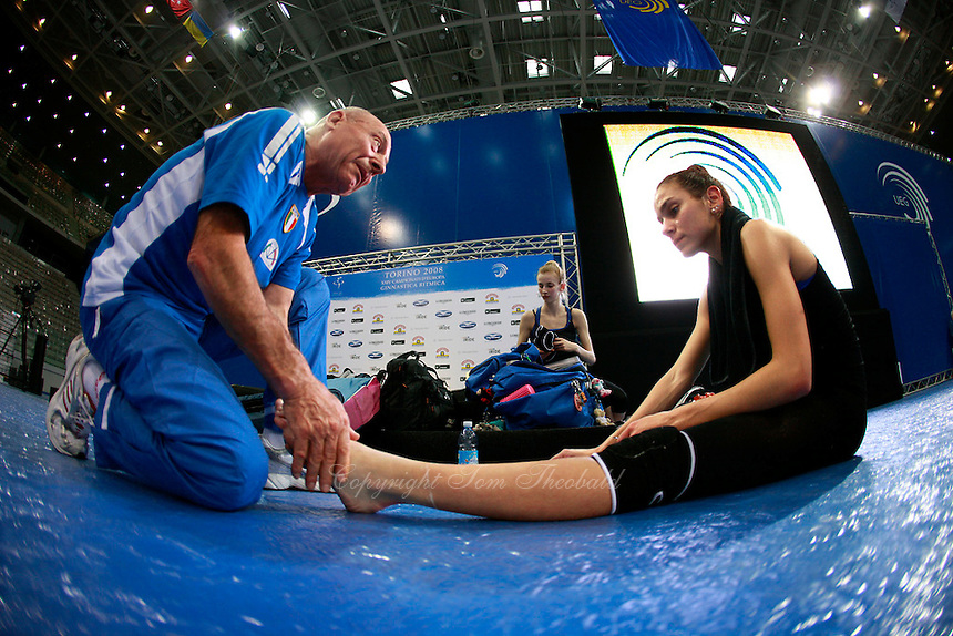 (L-R) Team trainer Tosi Pascuale works on foot of Elisa Santoni of Italian rhythmic group after trainings before 2008 European Championships at Torino, Italy on June 4, 2008.  Photo by Tom Theobald.