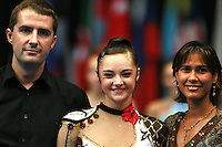 (Center) Anna Bessonova of Ukraine wins the D'Villena Prize for Elegance.  (L) Guillermo DNC, representing photographers and (R) Yenifer de Diniz of D'Villena Toe Shoes company to present the prize at 2006 Portimao World Cup of Rhythmic Gymnastics on September 9, 2006.  (Photo by Tom Theobald)