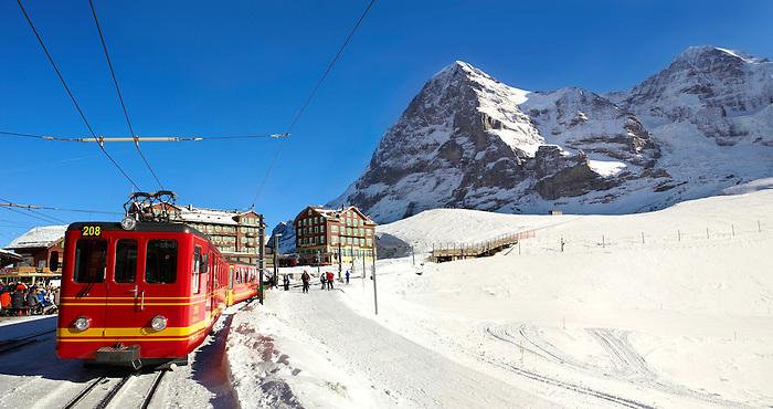 Jungfraujoch train at Kleiner Scheidegg in winter with The Eiger (left) then The Monch Mountains. Swiss Alps Switzerland