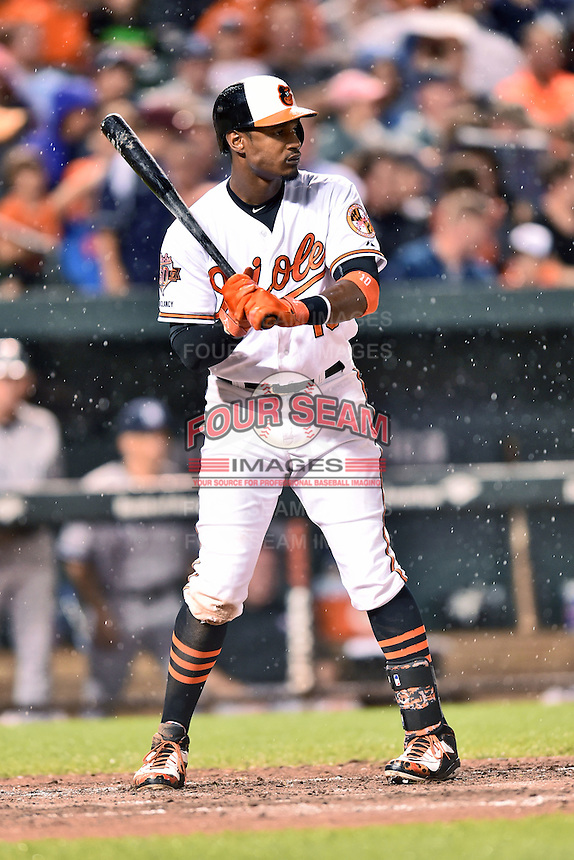 Baltimore Orioles center fielder Adam Jones #10 awaits a pitch during a game against the New York Yankees at Oriole Park at Camden Yards August 11, 2014 in Baltimore, Maryland. The Orioles defeated the Yankees 11-3. (Tony Farlow/Four Seam Images)