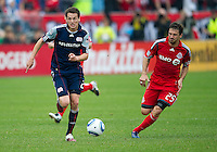 22 May 2010: New England Revolution midfielder Marco Perovic #29 and Toronto FC midfielder Martin Saric #25 in action during a game between the New England Revolution and Toronto FC at BMO Field in Toronto..Toronto FC won 1-0.....