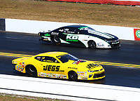 Mar 19, 2017; Gainesville , FL, USA; NHRA pro stock driver Jeg Coughlin Jr (near) races alongside Kenny Delco during the Gatornationals at Gainesville Raceway. Mandatory Credit: Mark J. Rebilas-USA TODAY Sports