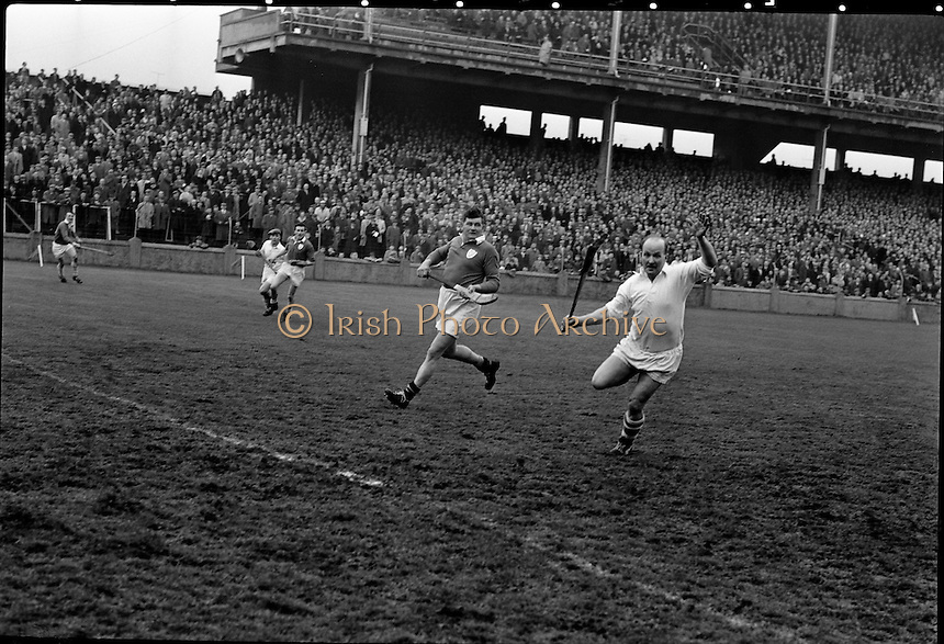 Railway Cup Final. Famed Cork hurler, Christy Ring, in full flight at the match with Leinster in Croke Park. Widely regarded as one of the greatest hurlers in the history of the game, he won eight senior All Ireland medals. .17.03.1963
