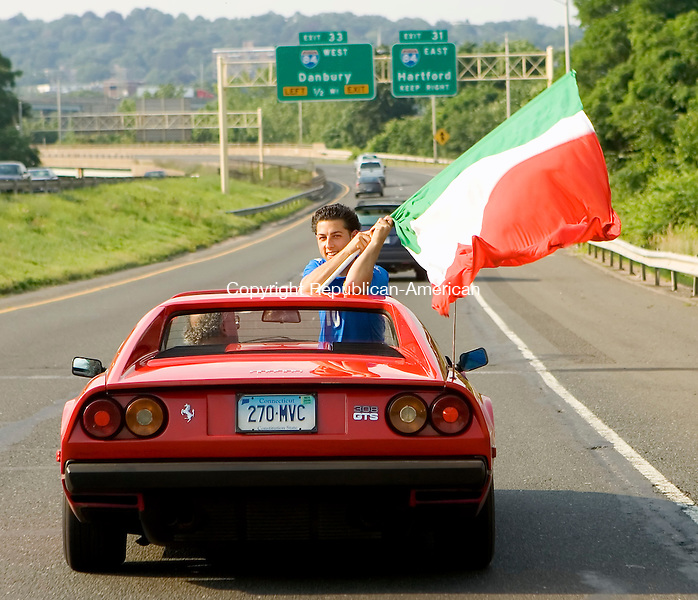 WATEBURY, CT--09 JULY 2006 -070906JS12-An unidentified Italian fan waves an Italian flag as fans drive around Waterbury on Sunday celebrating their teams win over France in the World Cup finals.  Jim Shannon Republican-American