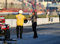 May 18, 2014; Commerce, GA, USA; NHRA top fuel driver Bob Vandergriff Jr (right) yells at a member of the safety safari  about the track conditions after crossing the center line and being disqualified during the first round of the Southern Nationals at Atlanta Dragway. Mandatory Credit: Mark J. Rebilas-USA TODAY Sports