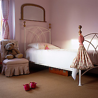 A little girl's bedroom is decorated in pink and white
