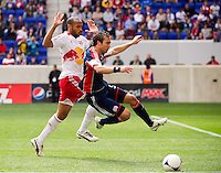 Thierry Henry (14) of the New York Red Bulls and A.J. Soares (5) of the New England Revolution. The New York Red Bulls defeated the New England Revolution 1-0 during a Major League Soccer (MLS) match at Red Bull Arena in Harrison, NJ, on April 28, 2012.
