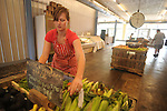 Alexe van Beuren puts the prices on items at BTC Grocery in Water Valley, Miss. on Wednesday, June 9, 2010.